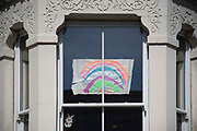 A rainbow drawing in a window in support of the NHS on 15th April 2020 in Greenwich, London, United Kingdom. Chancellor of the Exchequer, Rishi Sunak has said the Office for Budget Responsibility OBR, the UKs tax and spending watchdog suggests the coronavirus crisis will have serious implications for the UK economy, warning the pandemic could see the economy shrink by a record 35% by June, increasing unemployment by over 2 million and sending the budget deficit to its highest since World War II.