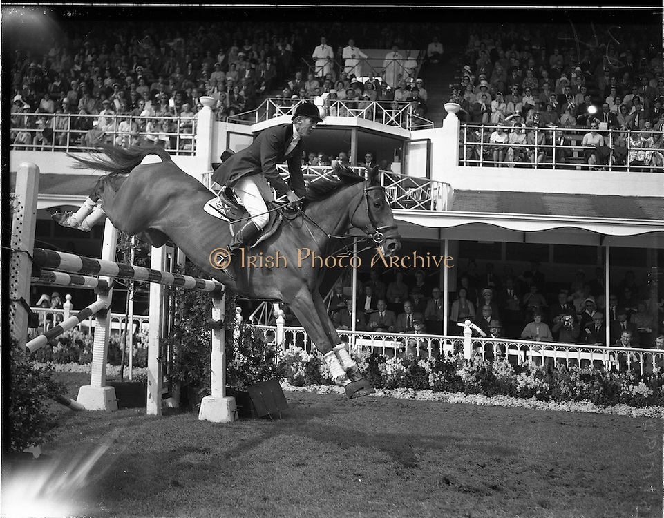"""04/08/1960<br /> 08/04/1960<br /> 04 August 1960<br /> R.D.S Horse Show Dublin (Thursday). David Broome Of Great Britain on """"Sunsalve"""", winner of the International Jumping Competition at the Dublin Horse Show, clearing a pole jump in Fine style."""