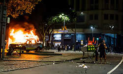 April 28, 2017 - Rio De Janeiro, Rio De Janeiro, Brazil - A street merchant looks on as a metro Rio truck burns in downtown Rio De Janeiro Brazil, Friday 28th April. Large scale protests took place throughout Brazil against the governments planed  changes to workers rights. (Credit Image: © Ch Gardiner/Pacific Press via ZUMA Wire)