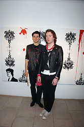 Left to right, PHIL COLBERT and RICHARD ASCOTT at The Week of Living Dangerously an exhibition and concert by Richard Ascott and Phil Colbert of fashion label Rodnik held at The Hospital, Endell Street, London on 25th March 2008.<br /><br />NON EXCLUSIVE - WORLD RIGHTS