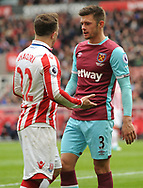 Aaron Cresswell of West Ham argues wth Sheridan Shaqiri of Stoke city. Premier league match, Stoke City v West Ham Utd at the Bet365 Stadium in Stoke on Trent, Staffs on Saturday 29th April 2017.<br /> pic by Bradley Collyer, Andrew Orchard sports photography.