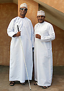 Two Omani men standing outside the Mutrah souk in Muscat, the capital of the Sultanate of Oman.