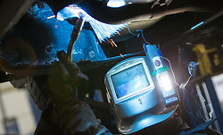 THEMENBILD - ein Mechaniker bei Schweissarbeiten an einem Kraftfahrzeug in einer KFZ- Werkstaette, aufgenommen am 13. Februar 2015, Maishofen, Österreich // a mechanic at welding work on a motor vehicle in a car Raipair Shop, Maishofen, Salzburg, Austria on 2015/02/13, Austria. EXPA Pictures © 2015, PhotoCredit: EXPA/ JFK