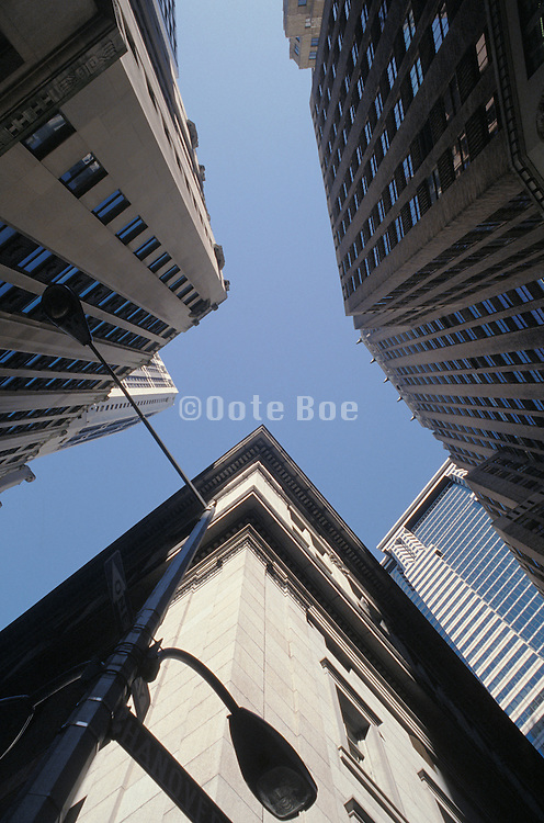upward view of buildings and lamp post