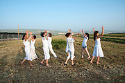 Dancing women celebrating spring harvest. Photographed at Kibbutz Ashdot Yaacov, Israel