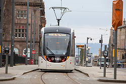 Tram on St Andrews Square. Edinburgh city centre on Tuesday 25th March, after the Lockdown.
