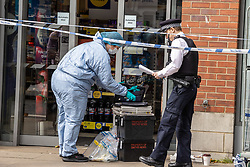 Licensed to London News Pictures. 26/08/202. London, UK. Police forensics examine a Local Tescos supermarket in Fulham, southwest London this morning after a man was arrested for contaminating food with syringes at three supermarkets last night. Tescos, Sainsbury's and a Waitrose on the Fulham Palace Road in London have been closed with forensic teams checking food stocks. Police have urged anyone who bought food on Wednesday evening at one of the stores to dispose of it as soon as possible. Photo credit: Alex Lentati/LNP
