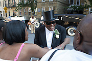 July 24, 2012-New York, NY:  Rev. Isaiah Owens, Funeral Director, Isaiah Owens Funeral Home attends the official Slyvia Woods Harlem Community memorial and send off through the streets of Harlem. Sylvia Woods was an American restaurateur who co-founded the landmark restaurant Sylvia's in Harlem on Lenox Avenue, New York City with her husband, Herbert Woods, in 1962 (Photo by Terrence Jennings)