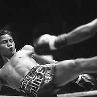 Asia, Thailand, Bangkok, Thai Kick Boxers fight during Muay Thai match at Sanam Muay Ratchadamnoen Stadium
