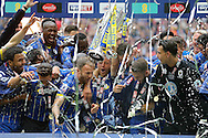 AFC Wimbledon players celebrate after they win the Sky Bet League 2 Play-off final.  Skybet football league two play off final match, AFC Wimbledon v Plymouth Argyle at Wembley Stadium in London on Monday 30th May 2016.<br /> pic by John Patrick Fletcher, Andrew Orchard sports photography.