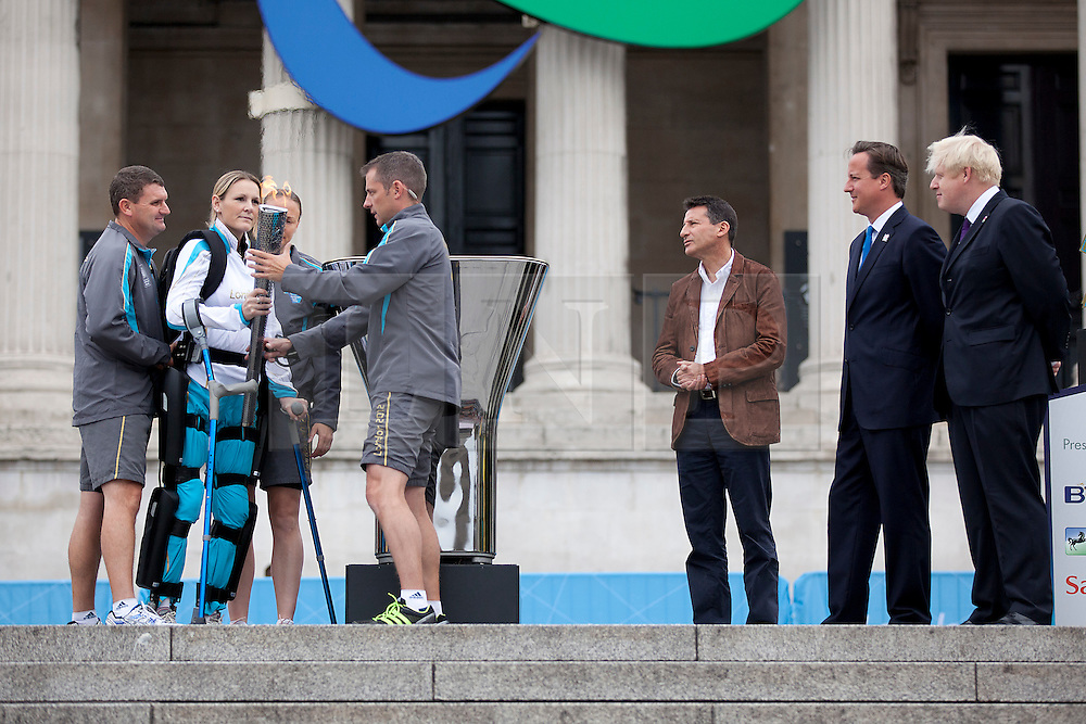 © Licensed to London News Pictures. 24/08/2012. LONDON, UK. Claire Lomas is watched by the Mayor of London, Boris Johnson (R), British Prime Minister, David Cameron (R2) and LOCOG Chairman Sebastian Coe (R3) as she prepares to light the Paralympic Cauldron in Trafalgar Square today (24/08/12). Ms Lomas, formerly a horse event rider, was paralysed from the chest down after being injured during the Osberton Horse Trials and completed the London Marathon in 2012. Photo credit: Matt Cetti-Roberts/LNP