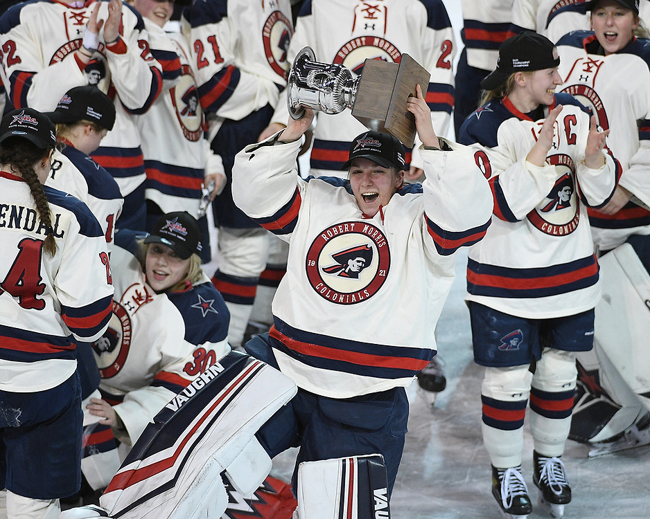 ERIE, PA - MARCH 06: Raygan Kirk #1 of the Robert Morris Colonials hoists the CHA Championship Trophy after the Colonials defeated the Syracuse Orange 1-0 in the championship game at the Erie Insurance Arena on March 6, 2021 in Erie, Pennsylvania. (Photo by Justin Berl/Robert Morris Athletics)