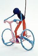 toy wire figure on bicycle