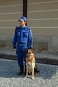 Japanese Guard with a watchdog at the Imperial Palace, Kyoto, Japan