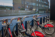 A large photograph of housing by artist, Mitra Tabrizian at Southwark underground station, on 13th January 2017 in London, England. The schemes bicycles are popularly known as Boris Bikes, after Boris Johnson, who was the Mayor of London when the scheme was launched. The operation of the scheme is contracted by Transport for London to Serco and the record for cycle hires in a single day is 73,000.