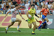 Australia's Liam McNamara makes a break to score during the HSBC World Rugby Sevens Series - Singapore , Bronze match Australia-V-England at The National Stadium, Singapore on Sunday, April 16, 2017. (Steve Flynn/Image of Sport)