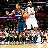 17 November 2013: Detroit Pistons point guard Brandon Jennings (7) drives past Los Angeles Lakers center Jordan Hill (27) during the Los Angeles Lakers 114-99 victory over the Detroit Pistons at the Staples Center, Los Angeles, California, USA.