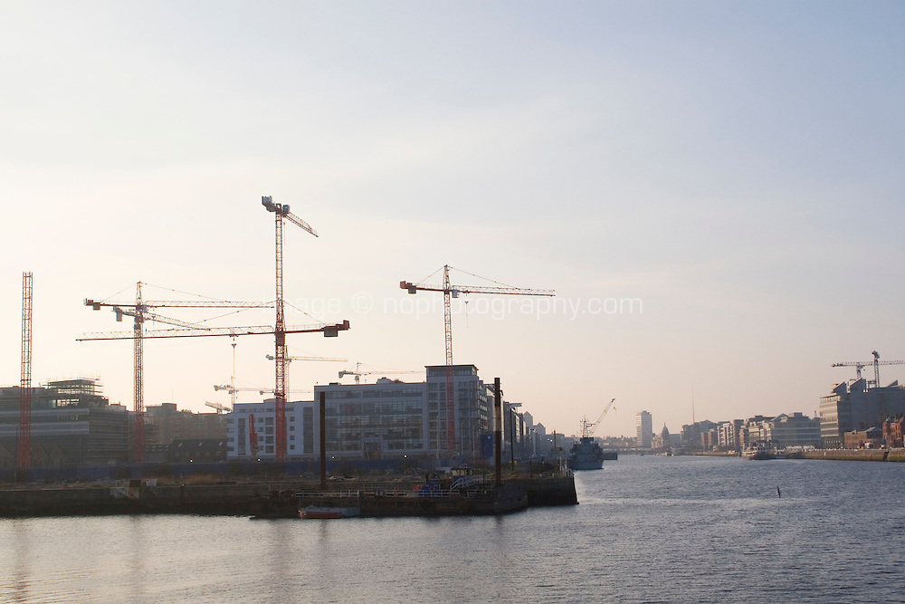 View from the East link bridge od construction in Dublin's docklands by the River Liffey in Ireland
