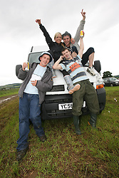 The first day was marred by traffic chaos in the main car parks.Gold car park at T. Gordon Ferguson, Jennifer Fraser, Iain McIver & Derek Hamilton..T in the Park festival took place on the 6th, 7th and 8 July 2007, at Balado, near Kinross in Perth and Kinross, Scotland. This was the first time the festival had been held over three days..Pic ©2011 Michael Schofield. All Rights Reserved..
