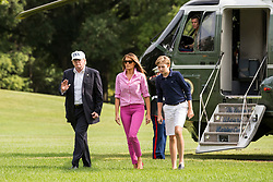 President Donald J. Trump accompanied by First Lady Melania Trump and their son Barron Trump, 11, exit Marine One on the South Lawn of the White House returned from a weekend trip to Camp David. Credit: Alex Edelman / Pool via CNP