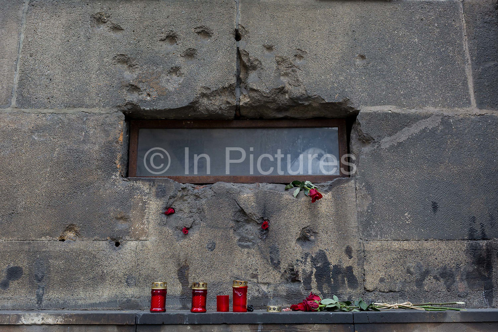 The war-damaged stonework forming the memorial to those killed by the Nazis in 1942 in the aftermath of Operation Anthropoid in which the highest-ranking Nazi, Reinhard Heydrich was assassinated during the occupation. The British-trained assassins and resistance members were eventually killed here, in the crypt of the Baroque Church of Sts Cyril and Methodius on Resslova street, on 19th March, 2018, in Prague, the Czech Republic.