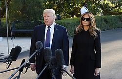 U.S. President Donald Trump with First Lady Melania Trump, answers questions from the press as they depart the White House for Joint Base Andrews, en route to Las Vegas, Nevada Oct. 4, 2017. The President and the First Lady will visit with civilian heroes and first responders from the deadliest mass shooting in U.S. history. Photo by Olivier Douliery/ Abaca Press
