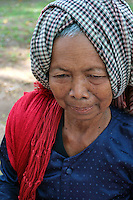 Cambodians traditionally wear a checkered scarf called a krama. The krama is what distinguishes Cambodians from their neighbors the Thai, the Vietnamese, and the Laotians. The scarf is used for many purposes - protection from the sun, for your feet when climbing trees, a hammock for infants, a towel or even as a sarong.