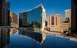 The Texas Medical Center in Houston featuring The Methodist Hospital Research Institute reflected in water.