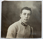 vintage studio head and shoulder portrait of a young adult man in uniform