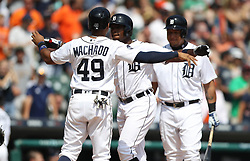 August 20, 2017 - USA - Detroit Tigers' Dixon Machado congratulates Justin Upton after his two-run home run against the Los Angeles Dodgers in the sixth inning on Sunday, Aug. 20, 2017 at Comerica Park in Detroit, Mich. (Credit Image: © Kirthmon F. Dozier/TNS via ZUMA Wire)