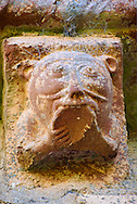 Norman Romanesque exterior corbel no 64 - sculpture of  an animal with a cat like head biting the underside of a bowl. The Norman Romanesque Church of St Mary and St David, Kilpeck Herefordshire, England. Built around 1140 .<br /> <br /> Visit our MEDIEVAL PHOTO COLLECTIONS for more   photos  to download or buy as prints https://funkystock.photoshelter.com/gallery-collection/Medieval-Middle-Ages-Historic-Places-Arcaeological-Sites-Pictures-Images-of/C0000B5ZA54_WD0s
