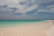 High clouds over emerald sea at Pink Sands Beach, Harbour Island, The Bahamas