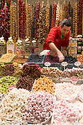 Seller of traditional sweetmeats Turkish Delight, Lokum in Misir Carsisi Egyptian Bazaar food and spice market, Istanbul, Turkey