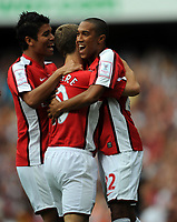 Jack Wilshire Celebrates Scoring 1st goal with team mates Gael Clichy and Eduardo<br /> Arsenal 2009/10<br /> Arsenal V Rangers 02/08/09 at the Emirates Stadium<br /> The Emirates Cup 2009<br /> Photo Robin Parker Fotosports International