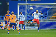 Paul McCallum (9) of Dagenham & Redbridge  clears the ball during the The FA Cup match between Mansfield Town and Dagenham and Redbridge at the One Call Stadium, Mansfield, England on 29 November 2020.