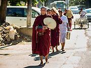 04 NOVEMBER 2015 - YANGON, MYANMAR:  Buddhist monks on the morning alms round in Yangon, Myanmar.       PHOTO BY JACK KURTZ