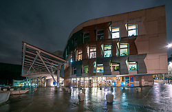 Night view of exterior of Scottish Parliament building at Holyrood in Edinburgh, Scotland, UK