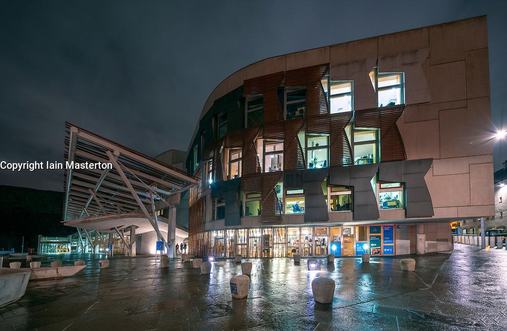 Night view of exterior of Scottish Parliament building at Holyrood in Edinburgh, Scotland, UK