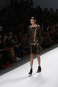 A short outfit with black lamé shorts and black sequined top by Richard Chai at the Spring 2013 Mercedes Benz Fashion Week show in New York.