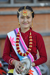 August 9, 2016 - Kathmandu, NE, Nepal - A Portrait of Hingish Subba, 16 yrs old, Nepalese Kirati girl in a traditional attire smiles as participate in the International Day of the 22nd World Indigenous Day celebrated in Kathmandu, Nepal, 09 August 2016. At the call of the United Nations, on August 9 every year the International Day of the World's Indigenous People observed by organizing different programs. (Credit Image: © Narayan Maharjan/NurPhoto via ZUMA Press)