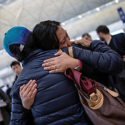 Vanessa Mae Rodel (42) says goodbye to her friends at Hong Kong International Airport on March 25, 2019, before flying to Canada. / Photo: Maria de la Guardia