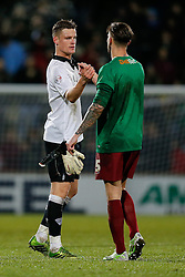 Matt Smith of Bristol City congratulates Emergency stand in Goalkeeper Andrew Boyce of Scunthorpe United (who stepped in after both regular goalies suffered broken arms in the first half) after Bristol win 0-2 - Photo mandatory by-line: Rogan Thomson/JMP - 07966 386802 - 17/01/2015 - SPORT - FOOTBALL - Scunthorpe, England - Glanford Park - Scunthorpe United v Bristol City - Sky Bet League 1.