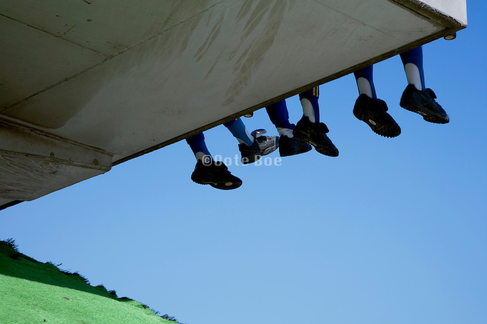 feet and legs of young boys in sports clothing
