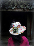 Tourist wearing a floral hat visits Tu Duc Tomb in Hue, Thua Thien Hue Province, Vietnam, Southeast Asia