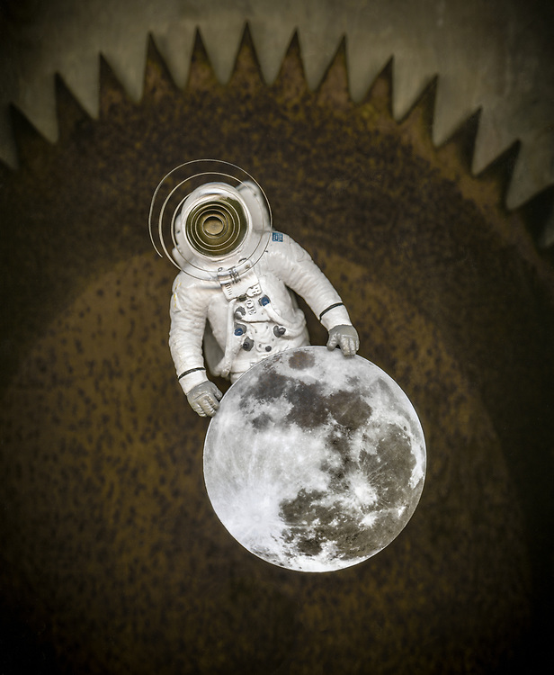 Man and the Moon.  Conceptual photo illustration, commemorating the Apollo moon landings, NASA and the astronauts.  It was a technological and political triumph, a victory in the space race, and the beginning of the digital age.