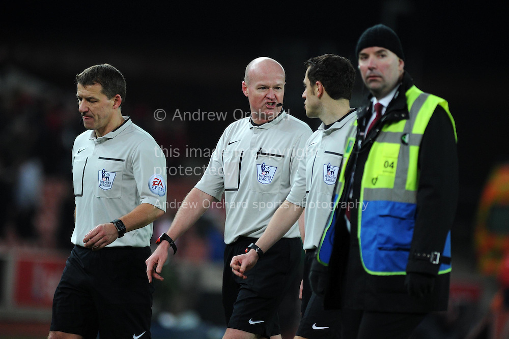 referee Lee Mason © walks off with his assistants at the end of the match. Barclays Premier League match, Stoke city v Manchester city at the Britannia Stadium in Stoke on Trent , Staffs on Wed 11th Feb 2015.<br /> pic by Andrew Orchard, Andrew Orchard sports photography.