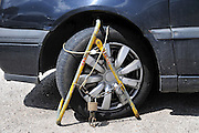 Car wheel clamped for illegal parking. Photographed in Israel