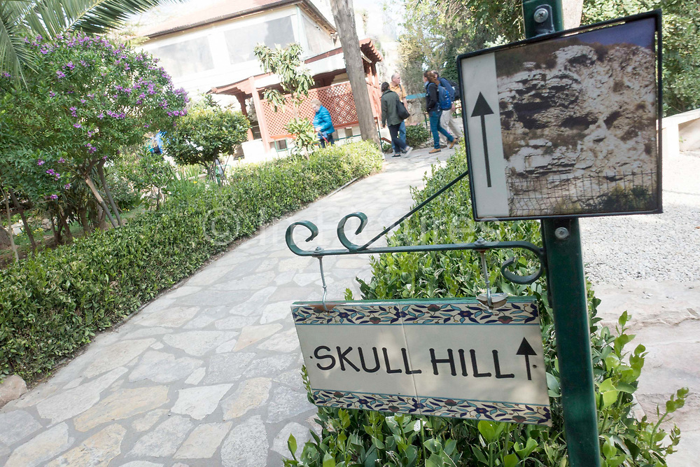 Skull Hill sign located in The Garden Tomb on 31st March 2016 in Jerusalem, West Bank. The Garden Tomb, Skull Hill, is a rock-cut tomb in Jerusalem which was unearthed in 1867 and is considered by some Christians to be the site of the burial and resurrection of Jesus.