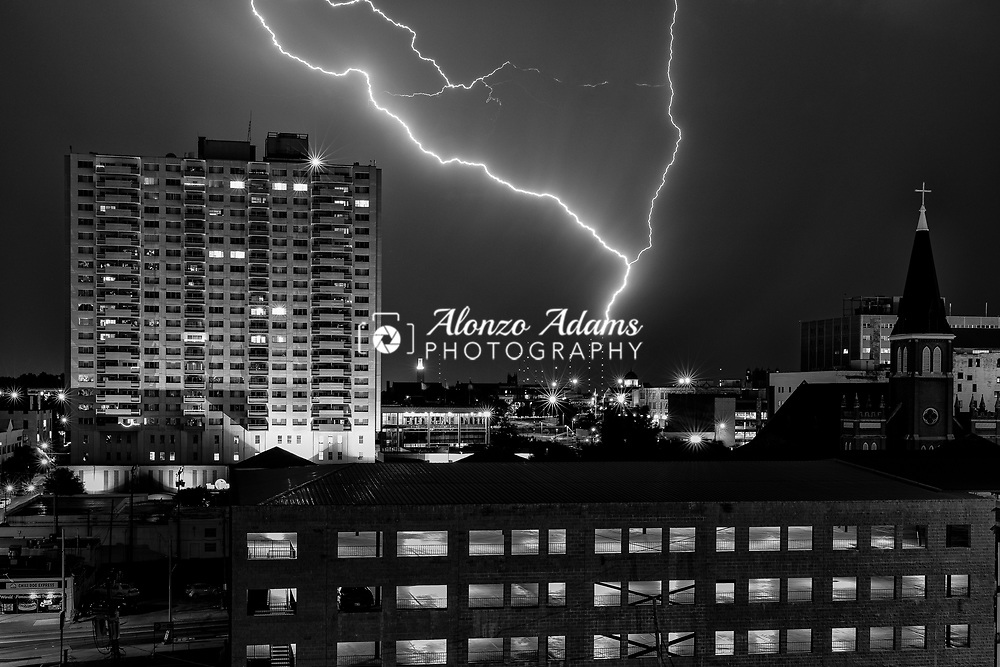 Upward lightning north of downtown Oklahoma City on June 14, 2019. Photo copyright © 2019 Alonzo J. Adams.