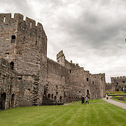 Interior Walls at Caernarfon Castle in northwest Wales. A castle originally stood on the site dating back to the late 11th century, but in the late 13th century King Edward I commissioned a new structure that stands to this day. It has distinctive towers and is one of the best preserved of the series of castles Edward I commissioned.